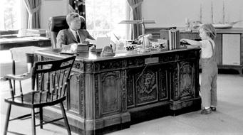 JFK sitting at Resolute Desk